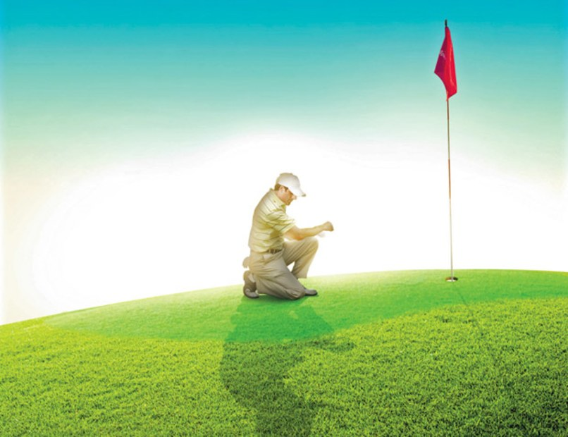 men kneeling on golf course